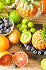 tropical fruit, pineapple, kiwi, red orange and blueberries