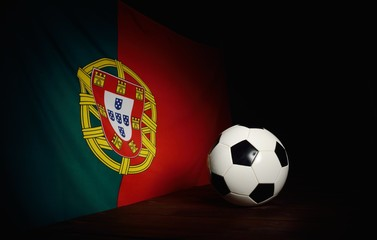Flag of Portugal with football on wooden boards as the backgroun