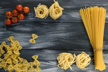 Pasta with tomatoes on wooden background