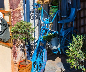 Old blue bicycle as decoration of inner yard on Santorini island, Greece