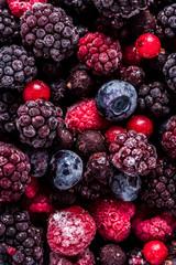 Frozen summer forest wild berries fruits, full frame background