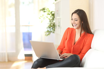 Woman working with a laptop at home