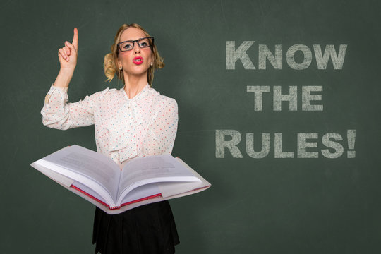Teacher holds rule book know the rules message classroom lecture discipline motivational card