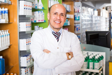 Male pharmacist in drugstore.