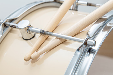 Wood snare drum and drumsticks isolated