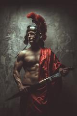 Muscular man in a Roman armour.