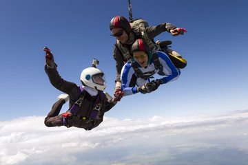 Parachutist student in tandem with an instructor.