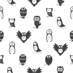 Vector seamless pattern with cute cartoon owls on  white background.
