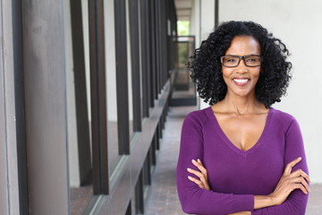 A pretty African american woman wearing glasses at work