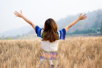 Girl is traveling into Barley field