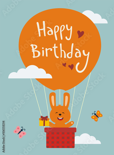 Happy Birthday! Funny Bunny Flying On Balloon With Birthday Gift In Hand. Happy  Birthday