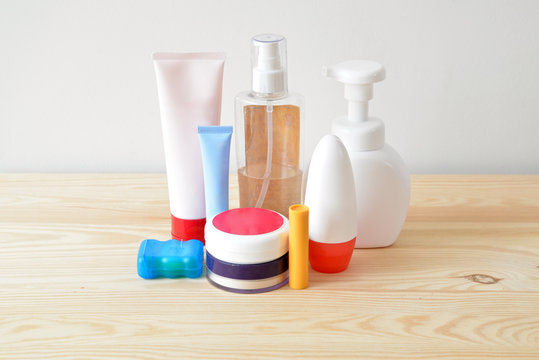 Colorful toiletries on the wooden cupboard