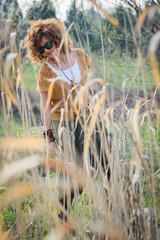 Fashion shot of a beautiful boho style girl. Boho style