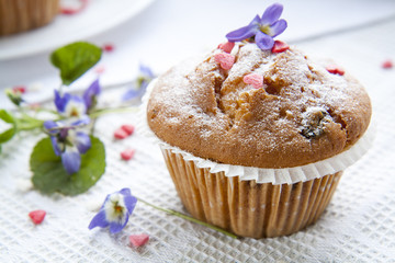 Tasty muffins with sugar hearts and cup of green tea