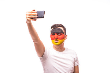 German football fan take selfie photo with phone on white background. European 2016 football fans concept.