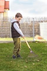 Child helping in the garden.