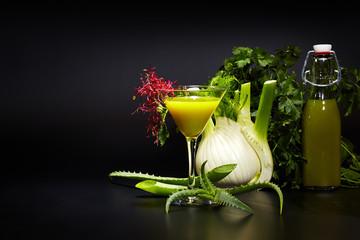 Fresh vegetable juices on black table