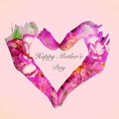 heart and text happy mothers day on a pink background