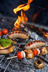 Grilling sausages on barbecue grill.