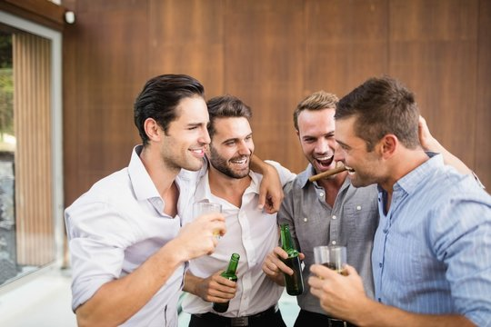 Group of young men having drinks