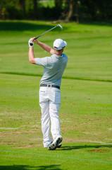 Deurstickers Golf Golfer hitting golf shot.