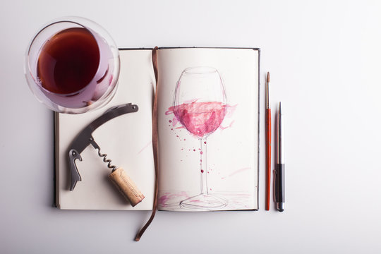 Sketch of a Glass of Wine in a Small Notebook