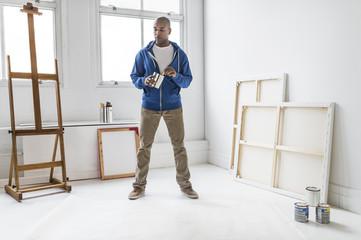 Black artist standing in studio