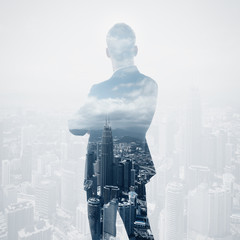 Photo of stylish adult businessman wearing trendy suit and looking city. Double exposure, panoramic view contemporary City background. Square