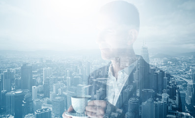 Photo of stylish adult businessman wearing trendy suit and holding cup coffee. Double exposure, panoramic view contemporary city. Horizontal