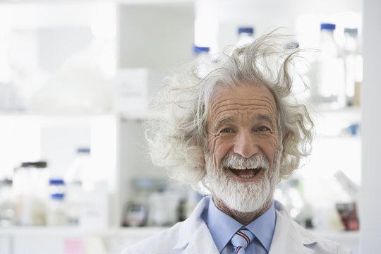 Senior Caucasian scientist with unruly hair in lab