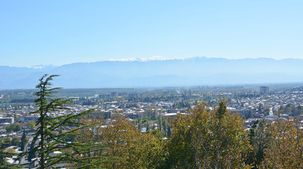 Panorama of the Kutaisi city (Georgia) and Caucasian mountains. View from Bagrati Cathedral.