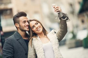 Couple in love taking selfie.
