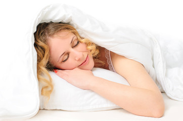 sleeping young woman covered with blanket