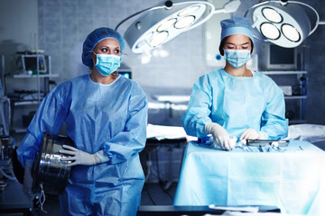 Caucasian surgeons preparing operating room