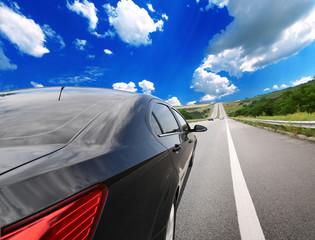 Motion blurred car on asphalt road