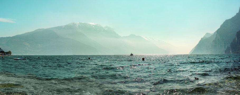 Garda lake panorama.Panoramic view of Lago di Garda near Riva with the Alps on the background. Italy, Europe