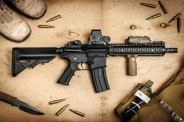 Assault rifle on a wooden table