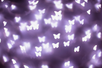 Purple butterfly bokeh lights. Bokeh defocused background