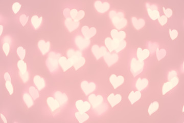 Heart bokeh background. Pastel pink color blurred texture