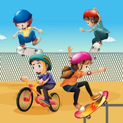 Children riding bike and skateboarding