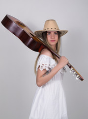 beautiful young leggy blond Country girl in a litl white dress and cowboy hat with a guitar