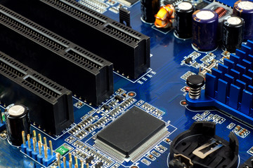 Close-up of electronic circuit board with processor. Small depth of field.