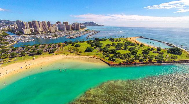 Aerial view of Magic Island Beach Park, Waikiki hotels, and Diamond Head