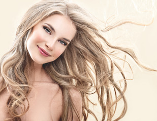 Long blond Hair.  Beauty Model Girl with Luxurious Hair.