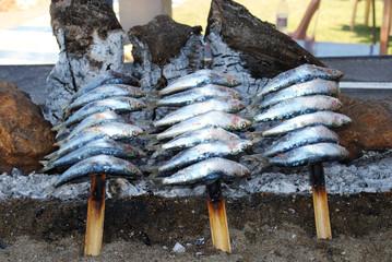 Sardines cooking on a beach barbecue, Benalmadena.