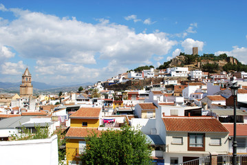 View of church and town rooftops with the castle to the rear, Velez Malaga.