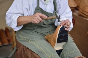 Closeup of shoemaker working