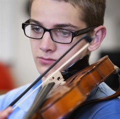 Caucasian boy playing violin