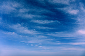 Clouds in the blue sky summer background