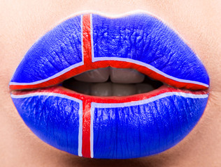 Female lips close up with a picture flag of Iceland. Blue, Red Cross.